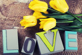 Word love and flowers — Stock Photo