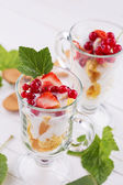 Cornflakes with red currant — Stock Photo