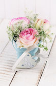 Fresh roses in bucket — Stockfoto