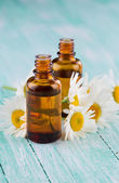 Aroma oil with chamomile — Stock Photo