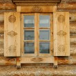 Window in a wooden peasant house — Stock Photo
