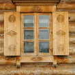 Stock Photo: Window in a wooden peasant house