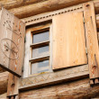 Stock Photo: Window in an ancient wooden peasant house