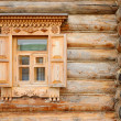 Stock Photo: Window in an wooden peasant house