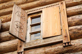Window in an ancient wooden peasant house — Stock Photo