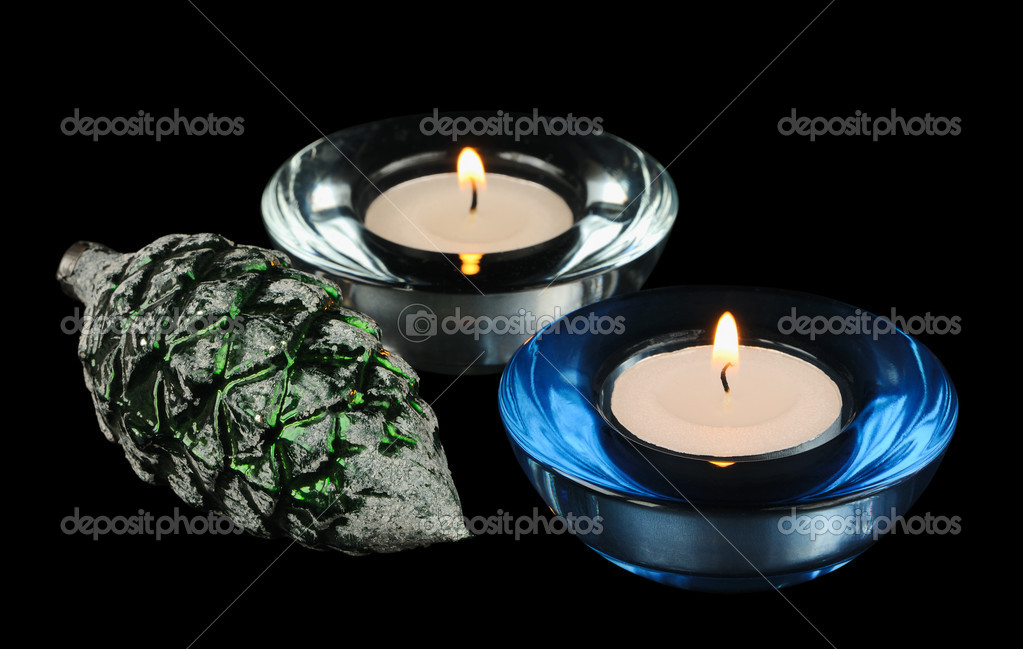 Two circular candle  and christmas-tree decoration on a black background — Stock Photo #18827601