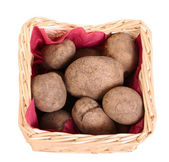Potatoes tubers in a basket — Stock Photo