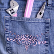 Working tools in a pocket of female jeans — Stock Photo