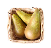 Three pears in a small basket — Stock Photo