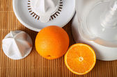 Fruit juicer and oranges — Stock Photo