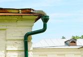 Rain gutter with drainpipe — Stock Photo