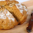 Newly-baked bread and a knife — Stock Photo