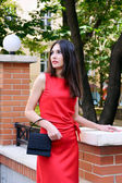 The girl in a red dress — Stockfoto