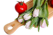 Still life with tulips and tomato — Stock Photo