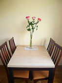 Table with flowers. — Stock Photo