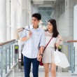 Stock Photo: Asian couple go shopping together