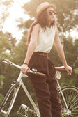 Woman sitting on bike. — Stock Photo