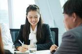 Businesswoman in meeting room — Stock Photo