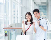 Asian couple shopping — Stock Photo