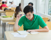 Asian student working in the library. — Stock Photo