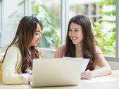 Asian students working in the library. — Stock Photo