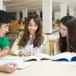 Asian students working in the library — Stock Photo