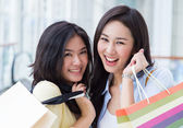 Happy young Asian women shopping. — Stock Photo