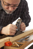 The joiner with a plane on a white background. — Stock Photo