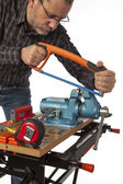 The joiner with the tool on a white background. — Stock Photo