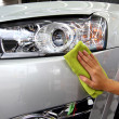 Hand with a wipe the car polishing car wash — Stock Photo