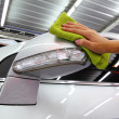 Hand with wipe car side mirror polishing car wash — Stok Fotoğraf #32009057