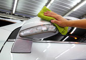 Hand with a wipe the car side mirror polishing car wash — Stock Photo