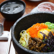 Stock Photo: Korecuisine : bibimbap in heated stone bowl