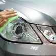 ストック写真: Hand with wipe microfiber car polishing