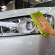 Stock Photo: Hand with wipe car polishing