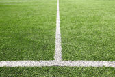 Soccer field grass on the green corner. — Stock Photo