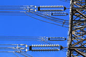 Electric high voltage pillar. Closeup of insulators. Sky background — Стоковое фото