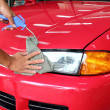 Hand with wipe car polishing — Stockfoto #32411395
