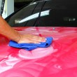 Hand with wipe car polishing — Foto Stock #32411569