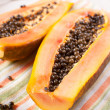 Halves of ripe orange papaya — Stock Photo