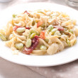 Cooked pasta with lima beans and prosciutto — Stock Photo