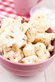 Cooked cauliflower florets with sauce — Stock Photo