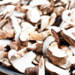 Sliced mushrooms on a frying pan - Stock Photo