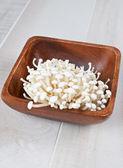 Uncooked enoki mushrooms vertical — Stock Photo