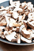 Sliced mushrooms on a frying pan — Stock Photo