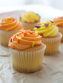 Cupcakes with orange and yellow frosting — Stock Photo