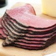 Deli pastrami meat sliced on cutting board — Stock Photo