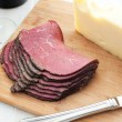 Stock Photo: Deli meat and cheese on cutting board