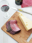 Deli meat pastrami and chunk cheese top view — Stock Photo