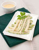 Zucchini fingers in batter and breadcrumbs — Stock Photo